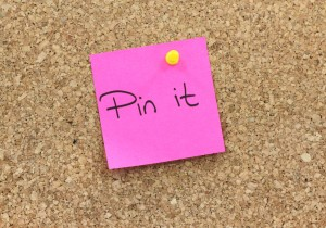 Picture of a post it note pinned to a bulletin board.