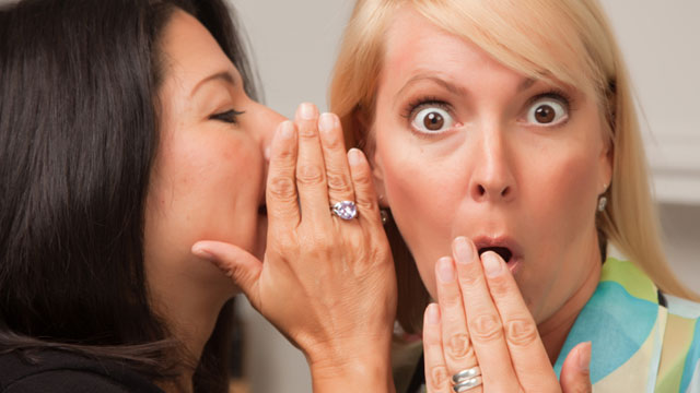 women-whispering-secrets