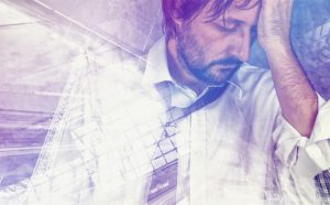 tired-exhausted-businessman-in-trouble-double-exposure-300x186