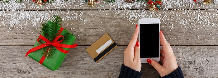 Woman-shopping-online-for-christmas-on-smartphone-862267256_700x250