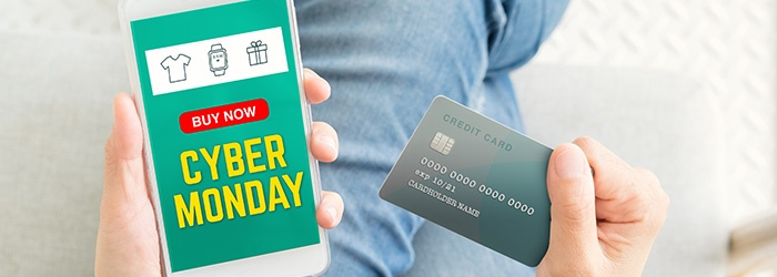 cyber-Monday-sale-using-credit-card-to-buy-with-promo-code,Top-view-close-up-woman-hand-shopping-online-with-mobile-app,digital-marketing-concept-865548406_700x250