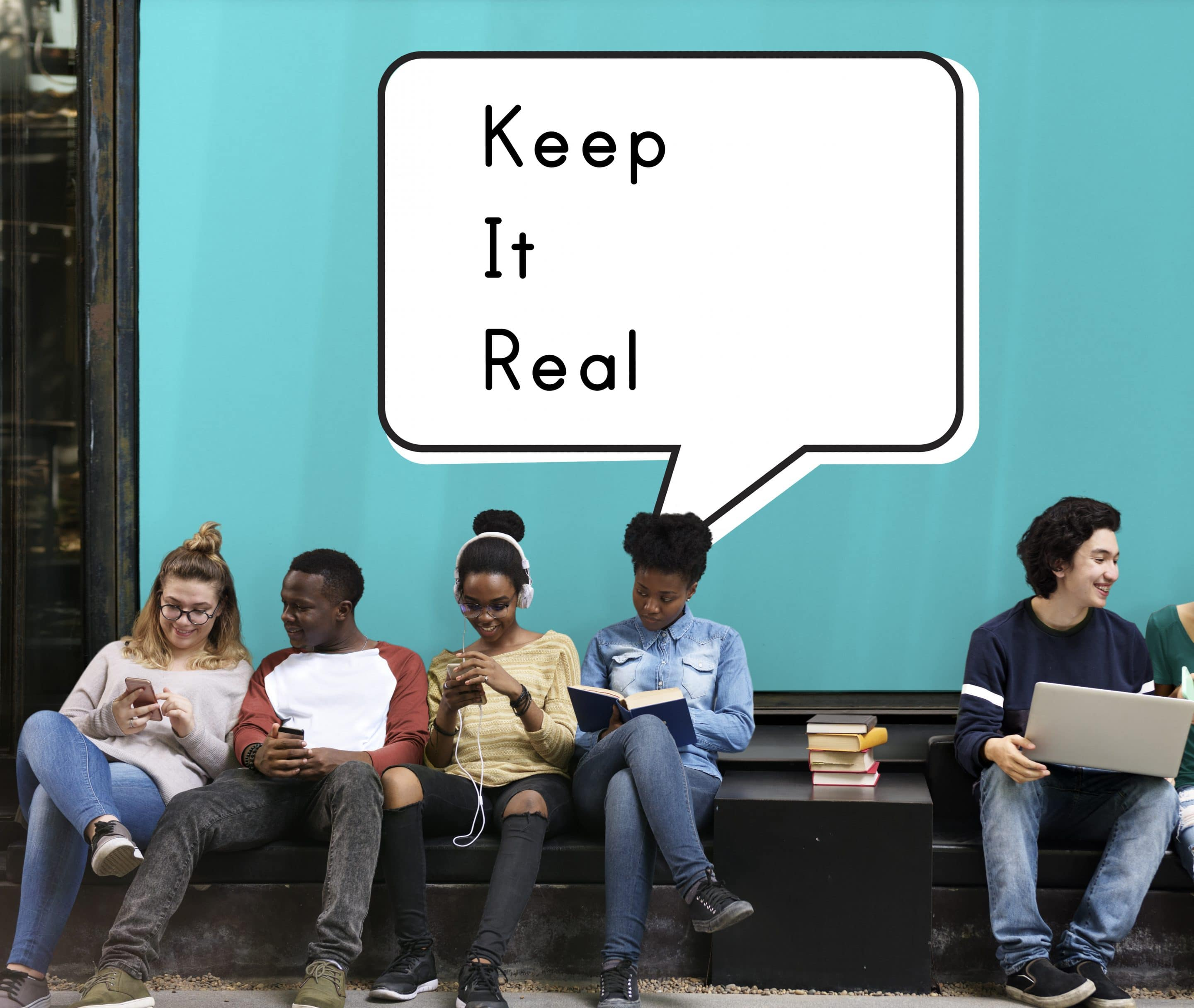 "Kids sitting on a bench under a ""keep it real"" sign showing what authentic social media branding is."